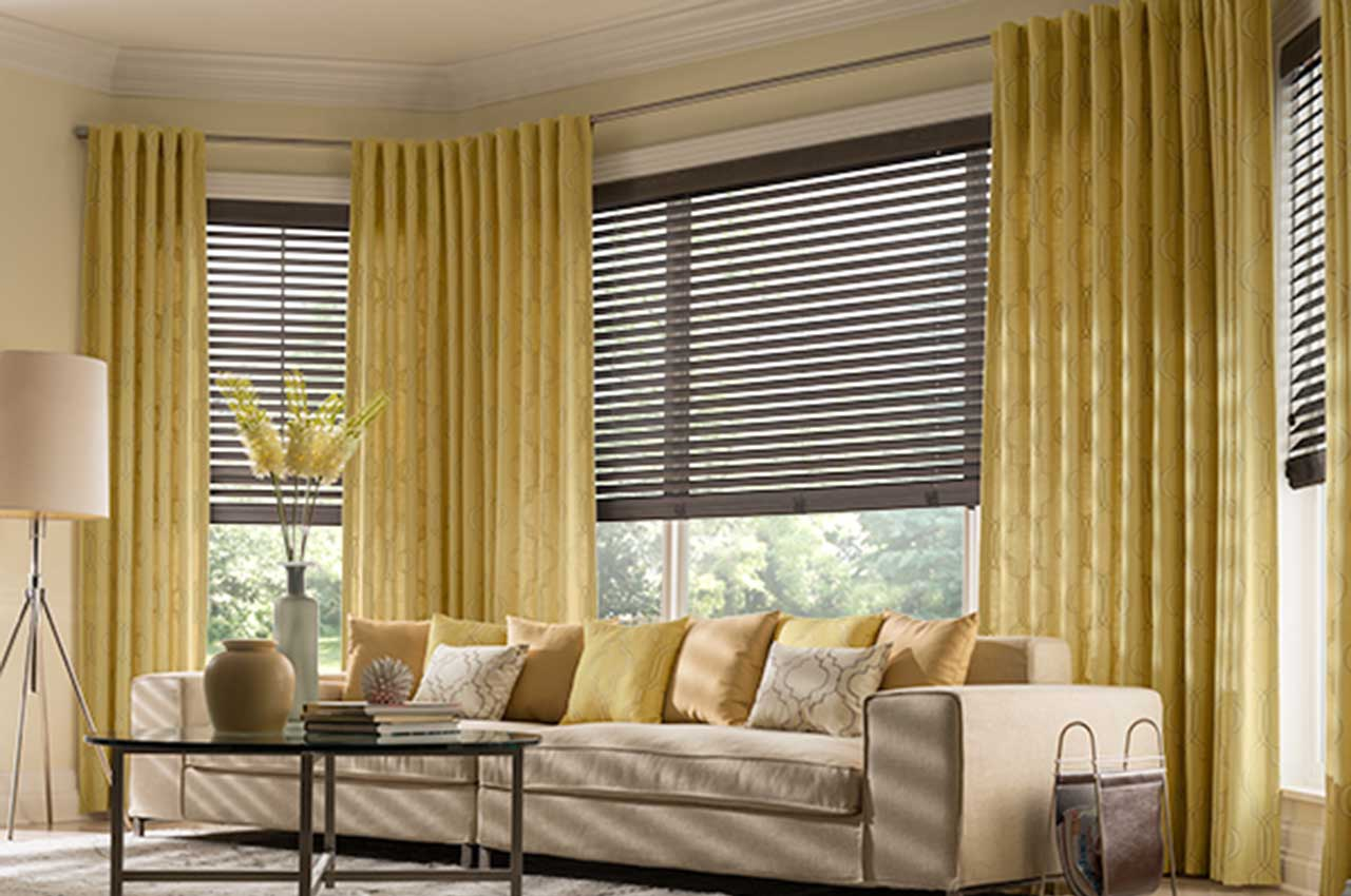 Wood Blinds Complement Draperies in Living Room Setting